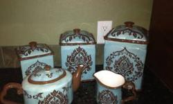 blue and brown 3 piece canister set with a matching tea pot and sugar dish. call if interested 719-240-7278