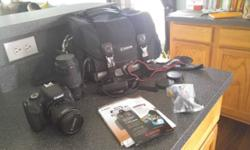 canon rebel T3i in great condition! no issues or damage to the camera or accessories whatsoever. includeds cannon case, strap, 300 mm zoom lens, battery charger, and tv connection kit, also all docume
