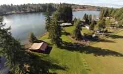 First time on market in 65 years- a rare opportunity to own 450+ feet of waterfront on gorgeous Henderson Inlet including a private cove. Nearly 15 acres of seclusion, fenced pastures, barn, and ranch