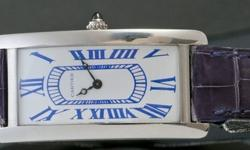 Fancy platinum Cartier Tank Cintre , limited edition of 50 pz, out of stock, new old stock , box and papers, exclusive special blue dial. Full warranty of originalty and perfect working conditions