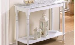 "A must-have for the romantic heart. Turned legs and an intricately carved top add rich visual appeal to this enchanting white wood table. Contents not included. Dimensions 35"" x 16.5"" x 29"" ITEMS CAN"