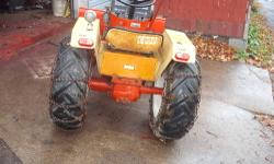 Has a 12hp Kohler K301,hydraulic drive tranny with high and low range also has the holding valve,16 inch rear ag tires with chains,new front tires, 54 inch snow plow,50 pounds cast iron wheel weights
