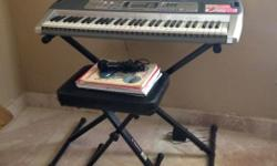 LIKE NEW Casio Keyboard with stand and bench. Original cost approximately $250