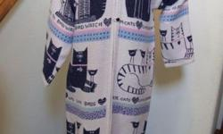 Woven afghan blanket coat jacket with felines, kittycats, birds and expressions. Coat has 3 black buttons with loop closure. (There is an extra button attached to the inner back edge). The phrases inc