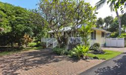 They don't make them like this any more! Utterly charming plantation style cottage with built in bookshelves, french doors, hardwood floors, plantation shutters. Great open floor plan flows to spaciou