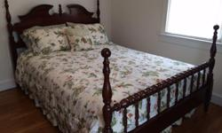 Type: Bedroom furniture Cherry wood four post bed. Side rails can be adjusted to fit either a queen or king size mattress. Night stand included in total price of $150.00
