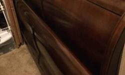 Have a beautiful wooden sleigh bed frame (king size) for sale. We recently purchased used, but realized it did not fit in our new bedroom so sadly have to part with it. Save for a slight crack along t
