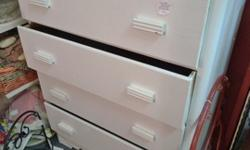 Four drawer cottage style chest painted white. Located at Four Seasons Vintage, 5710 Kingston Pike, Knoxville, TN 37919. Open Sunday afternoons and Mon - Sat 10am - 6pm. Phone 865-247-XXXX.