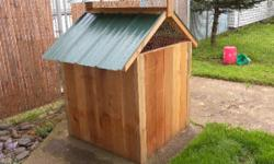 chicken coop for sale all exterior is made out of cedar and has a painted metal roof,interior has solid half inch ply floor.the roof opens on both sides one side to access your eggs and the other to c