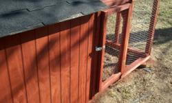 Redwood stained T-111 siding. Hindged nesting box on back of coop. Gate with hindges and hasp. 1 inch poultry wire and roosting pole inside. Shingled roof. Very solid and will last for years and years
