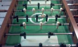 """Traditional Sport Fuball table Good Condition, Excellent working manages, glass field is in excellent condition, 2 Fuballs consisted of.  Dimensions. It is 35"""" high, 30.5"""" wide(manage length not accou"""