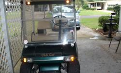 For sale is a 97 Club Car golf cart, green color, runs fine, is a 36 volt model, has aluminum frame (no rust) everything works as it should, recent service, comes with an automatic battery charger, lo