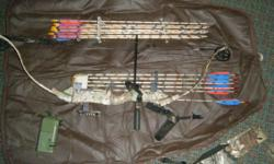 This bow has it all! It is made by Bear and comes with 1 1/2 dozen new arrows with broadheads and field tip points, sights, stabilizer, wrist strap, peep sight, quiver on the bow and one for a belt, a