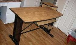 "Modern computer desk: 47"" wide, 24"" deep, 30' high (excluding top shelf). Shelf below for computer. Keyboard drawer. Simulated oak finish surfaces. I also have a quilt rack for $25, Drawing table $20"