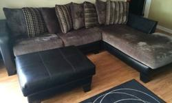 For sale is a great sofa that is about a year old. Materials are gray microfiber and black leather. I've moved to a smaller place so I need to downsize. I paid $1200 for it, yours for $300 OBO.