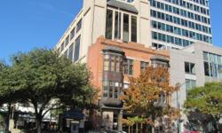 OF DOWNTOWN AUSTIN. JUST THREE BLOCKS FROM THE STATE OF TEXAS CAPITOL BUILDING, IT IS IN CLOSE PROXIMITY TO BOTH THE COURT HOUSE AND THE UNIVERSITY OF TEXAS. THE BUILDING WAS BUILT IN 1897 AND RENOVAT
