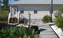 "Vacation at ""Living the Dream"" in Fort Morgan, AL Book directly with the owners and receive a 10% discount! Tired of spending your vacation in a high rise condo on a crowded beach? Living the Dream is"