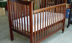 """Delta Baby 4-in-1 Bed / Crib with Kolcraft Mattress 4-in-1 Convertible Crib Delta Jasmine Model 4852-4 Expresso Cherry wood finish. 54"""" wide, 30"""" Deep, 48"""" High in back, 42"""" High in front. On Wheels."""
