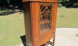 PRICE LOWERED!! Very clean Depression Era single door china cabinet. Cabinet has glass center door & full linen drawer, Front is inlaid & in excellent condition. All trim is good. Cabinet needs nothin
