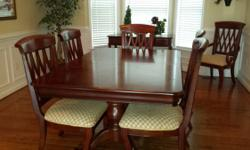 This is a extremely gorgeous and durable  diningroom set with 2 Captin Chairs and 4 routine chairs. The hutch is absolutely stunning with beveled glass. The table does have a bad spot ahead (my child