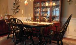 Type: Dining Room Type: Tables Large dining room table seats 6 comfortably and has two leaves that can open to seat at least 12 people. Two arm chairs and two side chairs included Always protected wit