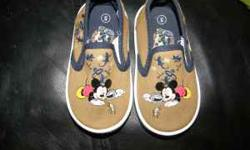 Size 5 toddler boy shoes. Disney brand shoes. Have mickey mouse on them. They are tan in color. They are canvas slip ons which are very convenient for putting them on your active little one. These sho