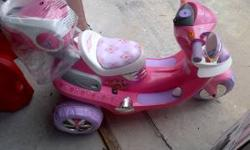 LIKE NEW motorized scooters for girls. With lights and sounds. This was used once, still has plastic wrappers. New it was 150 and its still new to the point you can put back in the box. Call 407-927-1