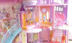 """Disney Princess Ultimate Dream Castle"" Over 3' tall and created for Barbie sized dolls. Was my child's Christmas present, however it turns out she's more interested in superheroes and only had fun wi"