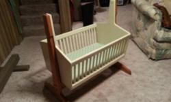 Bought this rocking baby crib for my daughter to put her American Girl dolls in however she doesn't utilize it anymore. Can hold up to 6 dolls. Strong wood and well made. Will make a great Christmas g