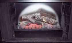 THIS IS A GORGEOUS UNIT, IT IS NOT JUST LOGS. IT FITS INTO A STANDARD FIREPLACE OPENING AND BURNS LIKE A REAL FIRE PLACE. IT HAS A REMOTE CONTROL, JUST PUSH THE REMOTE AND VOILA A NICE WARM BURING FIR