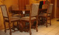 Sophisticated mint condition! With 6 chairs, this table can accommodate 8 individuals quickly. Solid wood, wonderfully crafted. With 20 inch leaf ... Original price $3000.00. Will certainly negotiate