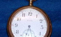 ELGIN 15 JEWEL POCKET WATCH. GOLD FILLED. ORIGINAL NUMBER # 18036457 DATES THIS WATCH TO 1914. ENSURED WORKING CONDITION. WATCH IS IN OVERALL GOOD CONDITION, WORKING AND KEEPS GOOD TIME. THE CRYSTAL I