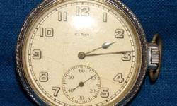 ELGIN 15 JEWEL SIDE WIND POCKET WATCH. BASE METAL SILVER COLOR. INITIAL NUMBER # 11652575 DATES THIS WATCH TO 1904. ENSURED WORKING CONDITION. VIEW IS IN OVERALL GOOD CONDITION, WORKING AND KEEPS GOOD