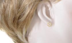 Dazzling and fascinating with their amazing cut and prestigious resplendence, the gorgeous diamonds weighing in total 1.10 carats are arranged in a floral shape in these fabulous 18K yellow gold earri