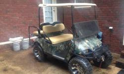 I have just restored this 2000 ez-go electric golf cart.  It has new batteries and wires, lift and tires, front and back seat, marine grade CD player and speakers, Crome steering shaft, wood grain das
