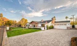 This stunning home was built in 2014 by the ever-talented RAFTERHOUSE and has been featured in Phoenix Home Garden, Arcadia News and on HGTV! It boasts nearly 4,200 square feet of exquisite living are
