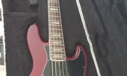 Fender American Deluxe Jazz Bass V 5-String Bass Guitar With Case, N3 noiseless pickups, switchable active/passive modes, an HMV bridge, and increased headroom. Body: Medium Ash (Wine Transparent) wit