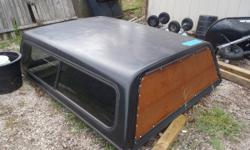 """Black fiberglass truck mattress topper off of 2004 Chevy Silverado extended taxicab (6' bed), Measures 5' 10"""" wide by 6' 9"""" long. My previous advertisement for the mattress topper had totally inaccura"""