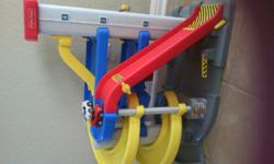 """Super awesome garage with race track ramp. It is out of production and """"vintage"""" so its built to last. It's also very large for real-live action play! (approx 31x19x20). Some of the stckers are worn b"""