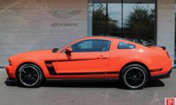 2012 Ford Mustang Boss 302 in Competition Orange with Charcoal Black Interior. 5.0-liter V8 engine that produces 444 horsepower and 380 lb/ft of torque, 6-speed manual trans. Two previous owners. Only