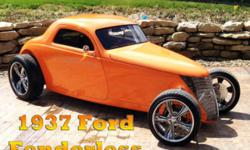 1937 Ford �Fenderless� Hot Rod This classic custom coupe is a collectors dream with well over $100K in it. This style hot rod was made on a 1937 Ford Chassis and it has a rare custom fiberglass bo