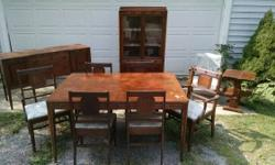 I have a complete dining room set for sale. It comes with a rectangular table with one leaf, 6 chairs, one buffet serving cabinet and one china cabinet. It also features a random chair and side table.