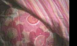 It works 4 full or queen size bed its pink,yellow and white stripped and flowered on the otherside its reversable it comes with 3 pillow cases,skirt and comforter.Call or txt NO EMAILS PLEASE.My num i