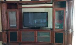 """1)Entertainment center with pull out storage for CDs/DVDs (10'6""""x6'9"""") with TV cabinet inside(3'5""""x5') $1200.00 2)Wooden circular spinner coffee table(3'9"""") dimension, $150. 3)Wooden kitchen table wit"""