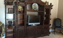 If you are looking for great furniture (2 1/2 yrs. old in excellent condition) you want to buy these...Tommy Bahama all wood entertainment center-11 ft approx. 3-pcs. $350Leather sofa-motorized reclin