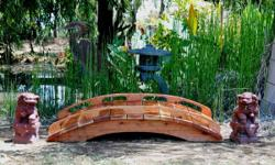 """Redwood Garden Bridges create handcrafted garden bridges to """"bring any backyard landscape alive"""". Providing a showcase for the company's services, and featuring a gallery of completed bridges, the sit"""