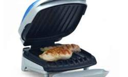 George Foreman Lean Mean Grillin' Machine - smaller size, two small burgers, chicken breasts or one huge one. Has the clear blue top bun warmer built in. Comes with grease catcher tray and plastic scr