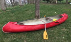 Used Golden Hawk Canoe Fiberglass body has been repaired & is water-tight Wood seats are usable but need repair Paddle & ski rope included Pick-up only