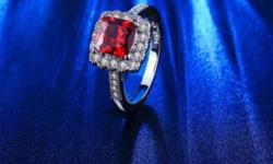 Will ship any item - $3 shipping Beautiful silver plated ring with 4 ct blood red CZ surrounded by sparkling white czs in a single line. Size 7 - $25 18K Yellow Gold Plated Green CZ earrings - Simple