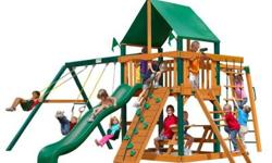 Get ready for excitement on the Navigator Deluxe Swing Set by Gorilla Playsets. This cedar wood swing set has all the excitement kids crave and the safety features parents demand. The Navigator Deluxe
